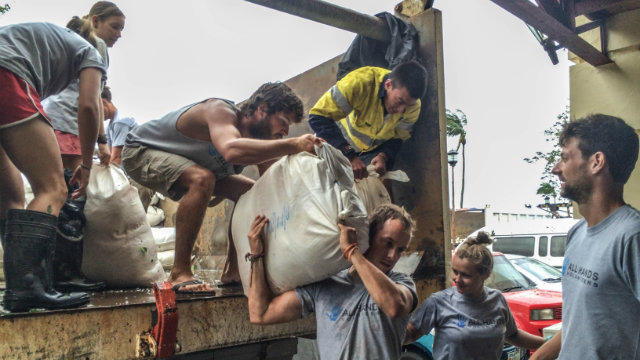 foreigners helping typhoon ruby victims