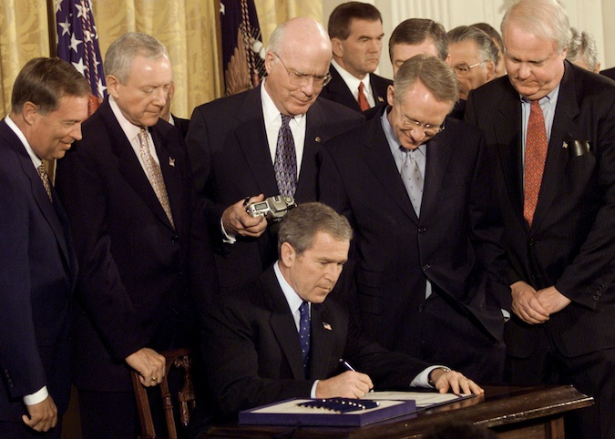 BUSH SIGNS ANTI TERRORISM BILL INTO LAW.