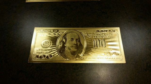neil-keenan-fake-gold-dollar2