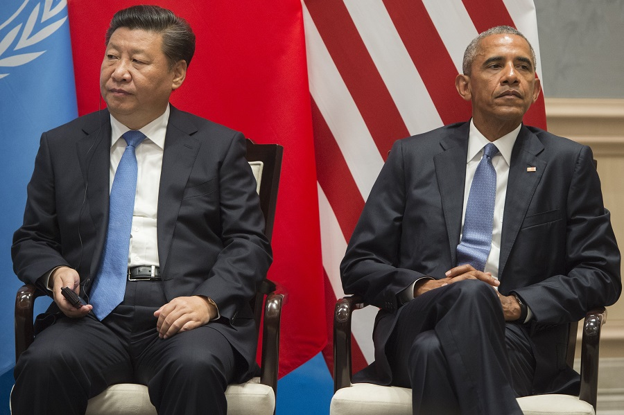 "US President Barack Obama and Chinese President Xi Jinping (L) look on after formally joining the Paris Climate deal at Ruyi Hall at the West Lake State House in Hangzhou on September 3, 2016. The United States and China on September 3 formally joined the Paris climate deal, with US President Barack Obama hailing the accord as the ""moment we finally decided to save our planet"". World leaders are gathering in Hangzhou for the 11th G20 Leaders Summit from September 4 to 5. / AFP / SAUL LOEB (Photo credit should read SAUL LOEB/AFP/Getty Images)"