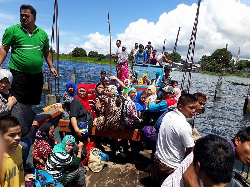 To avoid the heavy traffic, some Marawi residents fled the area by boat.