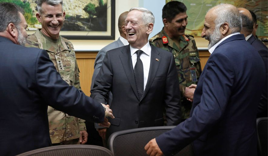 Defense Secretary James Mattis (center) met Monday with Army Gen. John Nicholson, the top U.S. commander in Afghanistan (second left), Afghan security director Mohammad Masoom Stanekzai (right) and other members of the Afghan delegation at headquarters in Kabul.