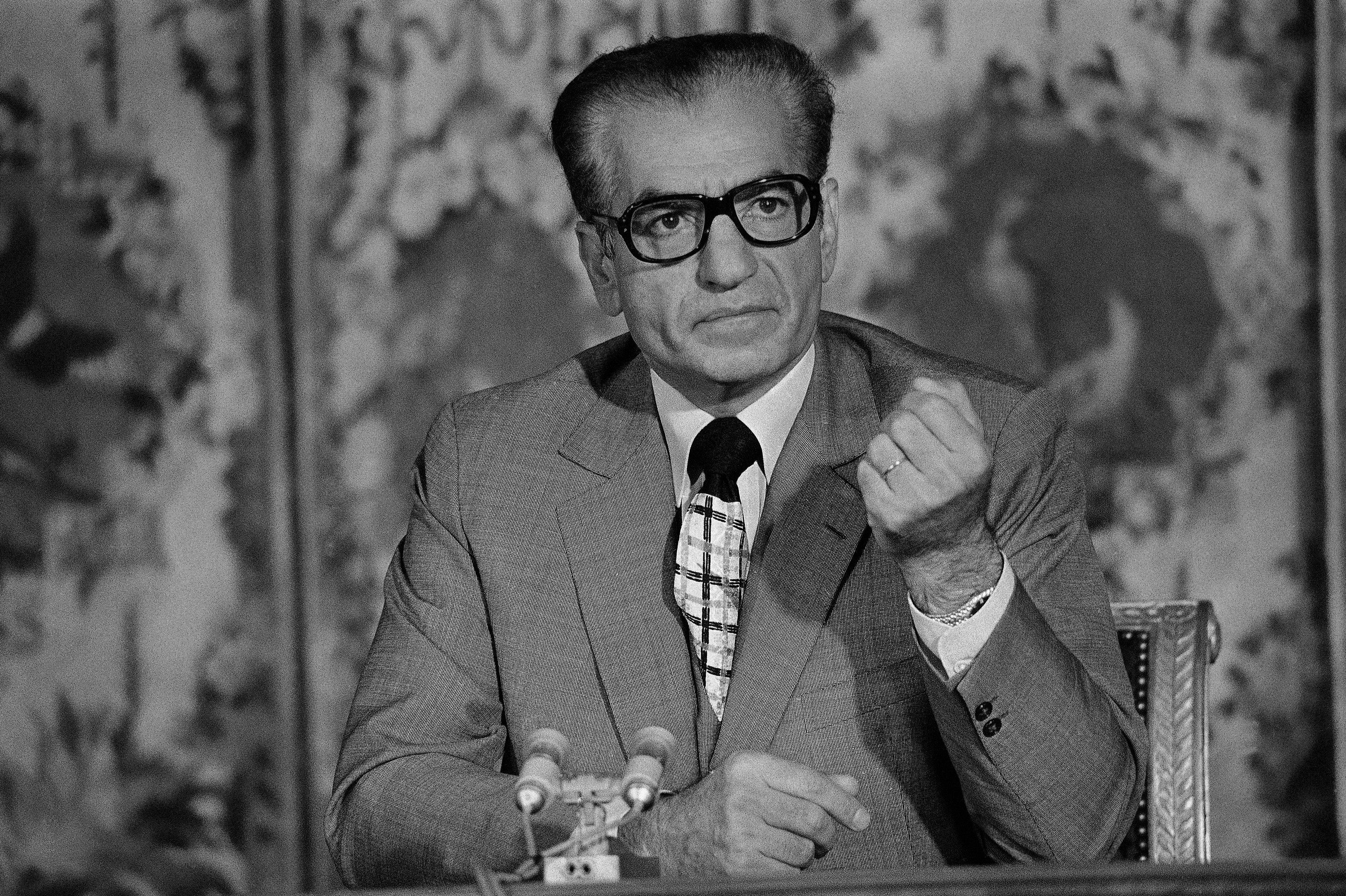 The Shah of Iran, Mohammad Reza Pahlavi, gestures during a press conference at the Trianon in Versailles, near Paris, France on June 27, 1974.