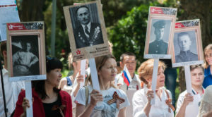 In May 2016, Russian marchers honoring family members who fought in World War II. (Photo from RT)