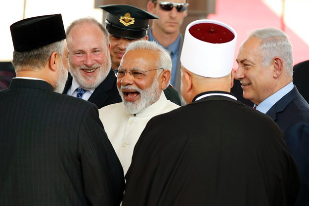 Modi becomes first Indian PM to visit Israel. Israeli Prime Minister Benjamin Netanyahu (R) introduces his Indian counterpart Narendra Modi (C) to religious officials during an official ceremony at the Ben-Gurion International airport near Tel Aviv on July 4, 2017. PHOTO: AFP