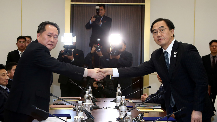Head of the North Korean delegation, Ri Son Gwon shakes hands with South Korean counterpart Cho Myoung-gyon / Reuters