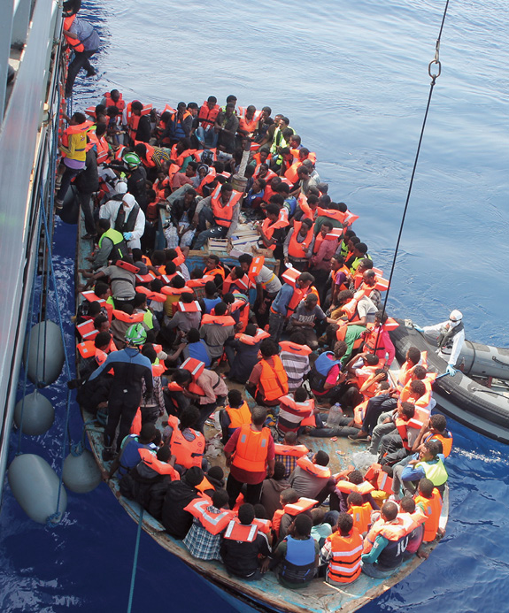 Irish Naval personnel rescuing migrants, June 15, 2015, as part of the EU's Mediterranean border patrol.