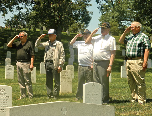 USS Liberty survivors (l-r) Wayne Hilldebrand, Terry McFarland, Bill Casper, Cal Landis and Dave Miller pay tribute to their fallen shipmates.