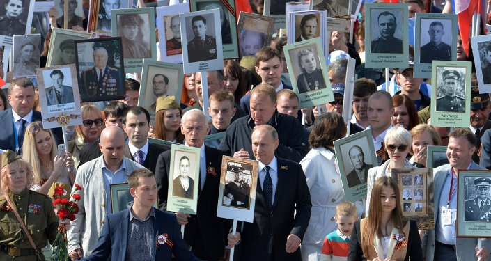 Putin joining the march of the Immortal Regiment carrying his father's portrait.