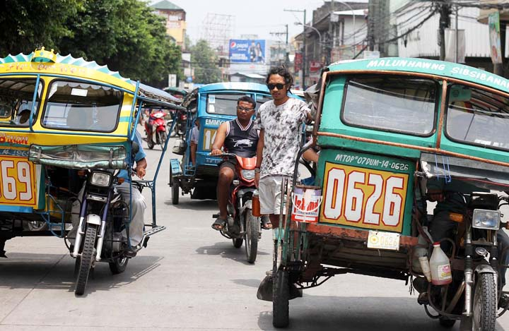 Pedicabs or tricycles ply the streets in Dumaguete City. Instead of jeepneys, tricycles dominate the public transportation area in this retirement destination. (Cheryl Baldicantos)