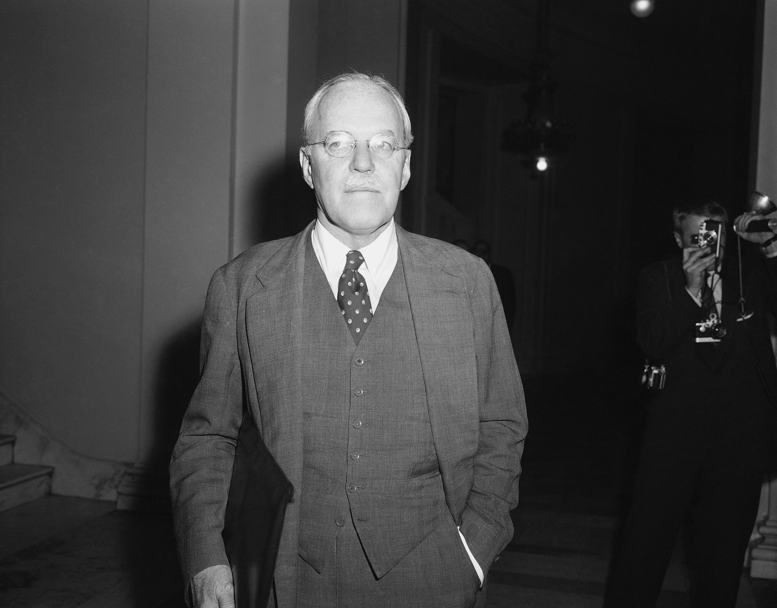 Allen Dulles, director of the Central Intelligence Agency, leaves the hearing room on Nov. 27, 1957, after giving closed door testimony before the senated preparedness subcommittee. Dulles told what Sen. Stuart Symington (D-Mo) called a sad and shocking story of the missile competition with Soviet Russia.