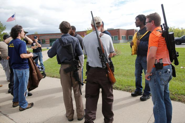 Open-carry gun activists hold a rally in Detroit, Michigan, U.S. on September 21, 2014. Picture taken on September 21, 2014. REUTERS/Rebecca Cook