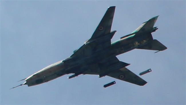 A Syrian Sukhoi SU-17 drops bombs over the militant-held parts of the Jobar district, on the eastern outskirts of the capital, Damascus, March 20, 2017. (Photo by AFP)