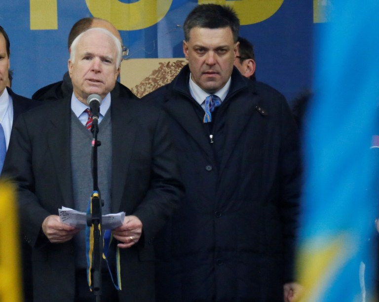 Senator John McCain (AZ) shares the stage in Kiev with far-right, NeoNazi Right Sector strongman, Oleg Tyhanbock, ahead of violent street protests in Ukraine in December of 2013, in advance of the US-backed coup.