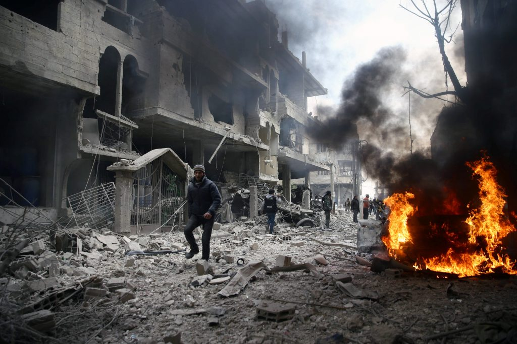 People are seen in the besieged town of Hamoria, Eastern Ghouta, in Damascus, Syria, Saturday. (Reuters/ Bassam Khabieh)
