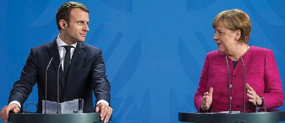 French President Emmanuel Macron (left) visits German Chancellor Angela Merkel in Berlin, May 15, 2017.